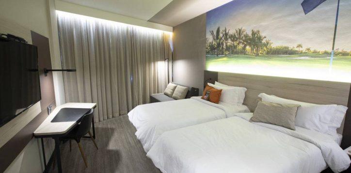apartamento-superior-2-camas-de-solteiro-e-sofa-cama-fechado-min
