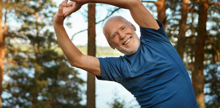 outdoor-shot-of-happy-energetic-senior-retired-man-enjoying-physical-training-in-park-doing-side-bends-exercise-holding-hands-together-with-broad-smile-warming-up-body-before-run-2