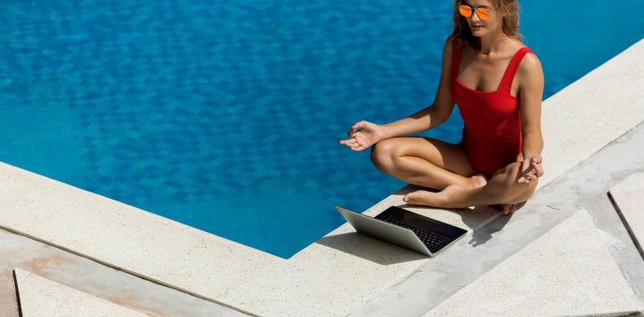 beautiful-girl-works-on-the-computer-near-the-pool-2