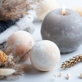 aroma bath bombs spa composition with dry flowers towels aromatherapy arrangement zen still life with grey lit candle body brushes