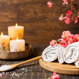 spa decoration with lit candles towels