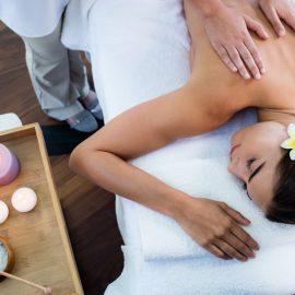 masseuse giving massage relax woman