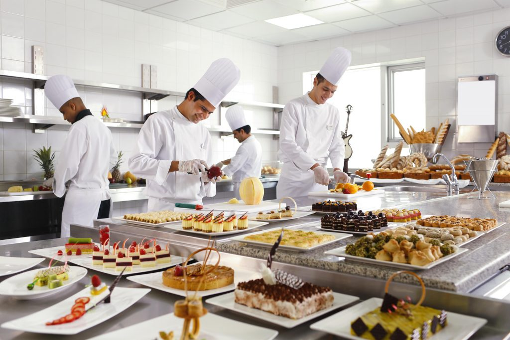 Chefs preparing food in the Swissotel Makkah hotel restaurant
