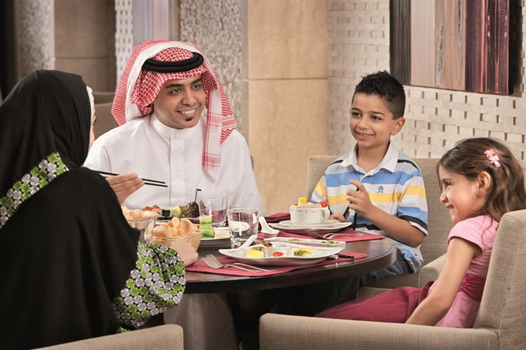 Family eating at Fairmont Makkah Aja Asian Restaurant