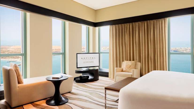 imperial-suite-club-millesime-access-1-king-bed-separate-living-room-sea-and-city-view